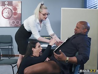 Angela White spreads her toes for a friend's black detect on the table