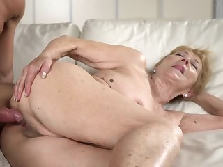 A nasty old granny gets a hard locate between the brush legs exposed to the sofa