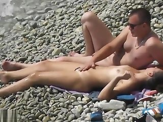 Couple Has Lovemaking On The Beach