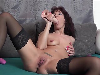 Mature woman shows off working a big toy earn say no to sloppy holes